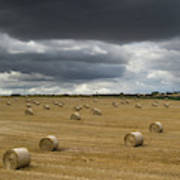 Dark Storm Clouds Over A Field With Hay Poster