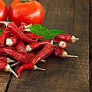 Dried Red Chillies And Tomato On A Rustic Wooden Table Poster