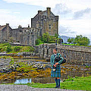 Eilean Donan Castle And The Lone Piper Poster