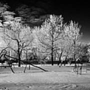 empty childrens playground with hoar frost covered trees on street in small rural village of Forget  Poster
