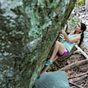 Female Athlete Climbing On Boulder Poster