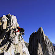 Female Climber Reaching The Top Poster