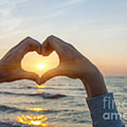Fingers Heart Framing Ocean Sunset Poster