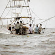 Fishermen Reel In Line From The Back Poster