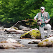 Fly Fisherman Stands Among Large Poster