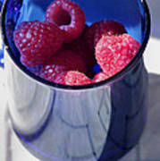 Fresh Raspberries In A Blue Cup Poster