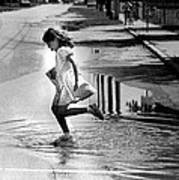 Girl Playing In A Puddle Poster by Retro Images Archive