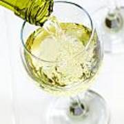 Glass Of White Wine Being Poured Poster