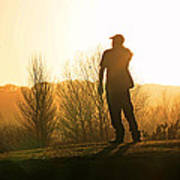 Golfer At Sunset Poster
