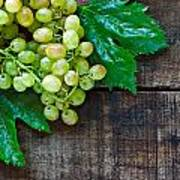 Green Grapes On A Rustic Wooden Table Poster