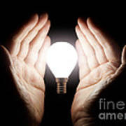 Hands Holding Light Bulb Poster