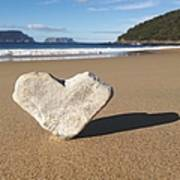 Heart Shaped Rock Sitting In Sand At Poster