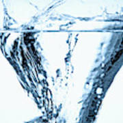 Ice Cube Splashing Into Water Poster
