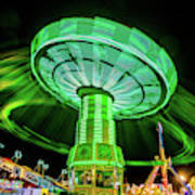 Illuminated Fair Ride With Blurred Neon Poster
