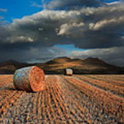 Landscape Of Hay Bales In Front Of Mountain Range With Dramatic  Poster