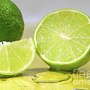 Limes On Yellow Surface Poster