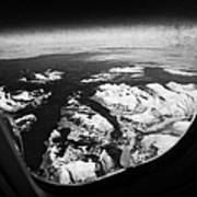 Looking Out Of Aircraft Window Over Snow Covered Fjords And Coastline Of Norway  Poster by Joe Fox