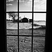 looking out through door window to snow covered scene in small rural village of Forget Poster
