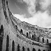 Looking Up At Blue Cloudy Sky And Upper Tiers Of The Old Roman Colloseum At El Jem Tunisia Poster