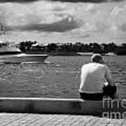 Man Fishing On Mallory Square Seafront Key West Florida Usa Poster by Joe Fox