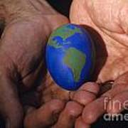 Man Holding Earth Egg Poster by Jim Corwin