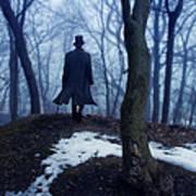 Man In Top Hat Walking Through Foggy Woods Poster