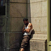 Man Leaning Against Wall In Sun Poster