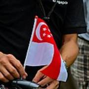 Man Plants Singapore Flag On Bicycle Poster