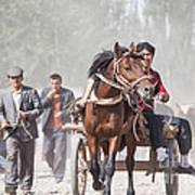 Man Riding A Carriage At Kashgar Sunday Market China Poster
