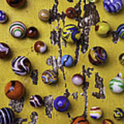 Marbles On Yellow Wooden Table Poster