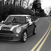 Mini-cooper Car Driving On Double Yellow Country Road Poster