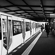 modern yellow u-bahn train sitting at station platform Berlin Germany Poster