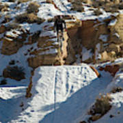 Mountain Biker Jumping With Snowy Poster
