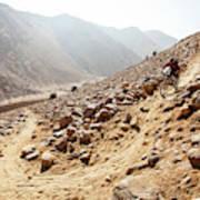 Mountain Biker Rides Through Rocky Poster