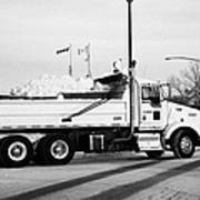 municipal city dump truck taking away snow cleared from parking lots and roads in Saskatoon Saskatch Poster
