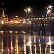 Night On Santa Monica Beach Pier With Bright Colorful Lights Reflecting On The Ocean And Sand Fine A Poster
