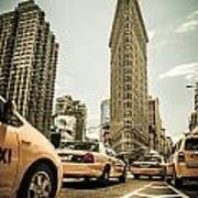 Nyc Yellow Cabs At The Flat Iron Building - V1 Poster by Hannes Cmarits