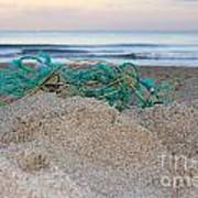 Old Fishing Net On Beach Poster