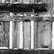 old patched up wooden fence using old bits of wood in snow Forget Poster