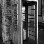 old style red telephone box with missing door in Carnlough county antrim Poster