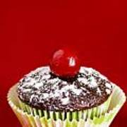 One Chocolate Cupcake With Cherry Over Red Poster