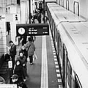 passengers along ubahn train platform Friedrichstrasse Friedrichstrasse u-bahn station Berlin Poster