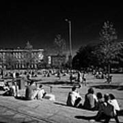 people sitting enjoying the sunshine Eyre Square in the heart of Galway city county Galway Republic of Ireland Poster