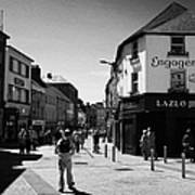 people walking down pedestrian area william street on a sunday Galway city county Galway Republic of Poster