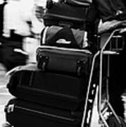 pile of luggage on trolley being pushed out of Reina Sofia Sur TFS South Airport Tenerife Canary Islands Spain Poster