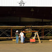 Pilot Works On Antique Plane In Hood Poster