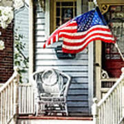 Porch With Flag And Wicker Chair Poster