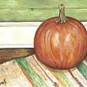 Pumpkin On A Rag Rug Poster