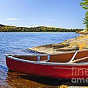 Red Canoe On Shore Poster