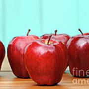 Red Delicious Apples On Old School Desk Poster